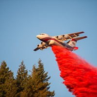 A plan drops a fire suppressant on a blaze yesterday near Blue Lake.