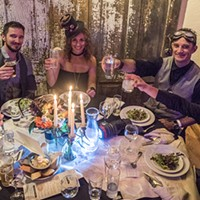 A table of guests at the Fall Splendor event toasts in their steampunk finery.