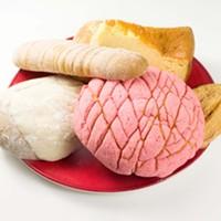Clockwise from top: cheesecake, oreja, concha, cinnamon concha and elotito.