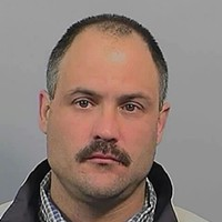 Ronald Crossland's state inmate photograph.