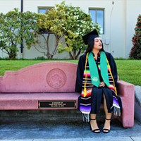 Rosibeth Cuevas, 21, sits on a bench that was dedicated to those who died in a 2014 bus crash in Orland. A survivor of the crash, Cuevas is now graduating from Humboldt State University.