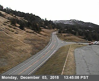 Emergency vehicles prepare the landing zone for the helicopter at Berry Summit. - CALTRANS TRAFFIC CAM