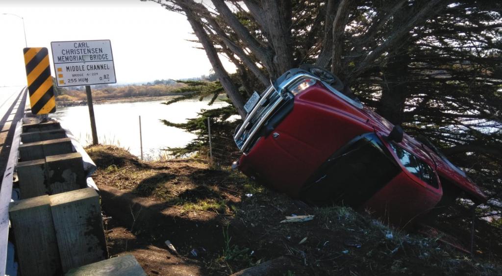 A  pickup flipped off the Samoa Bridge. - BOBBY KROEKER