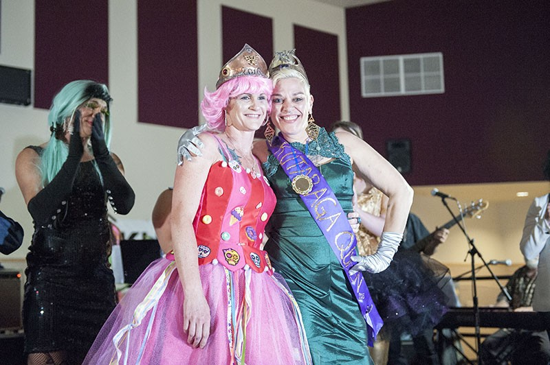 PoiSin Candie, left, celebrates being crowned the 2016 Rutabaga Queen with 2015 Queen Glorya Kiddnetica. - MARK MCKENNA