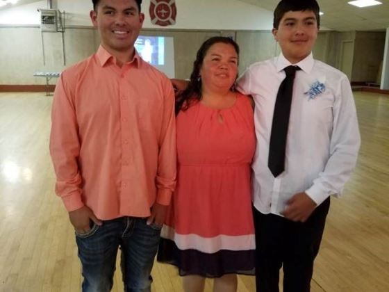 Lopez (right) with family in a photo on a crowdfunding page. - YOUCARING