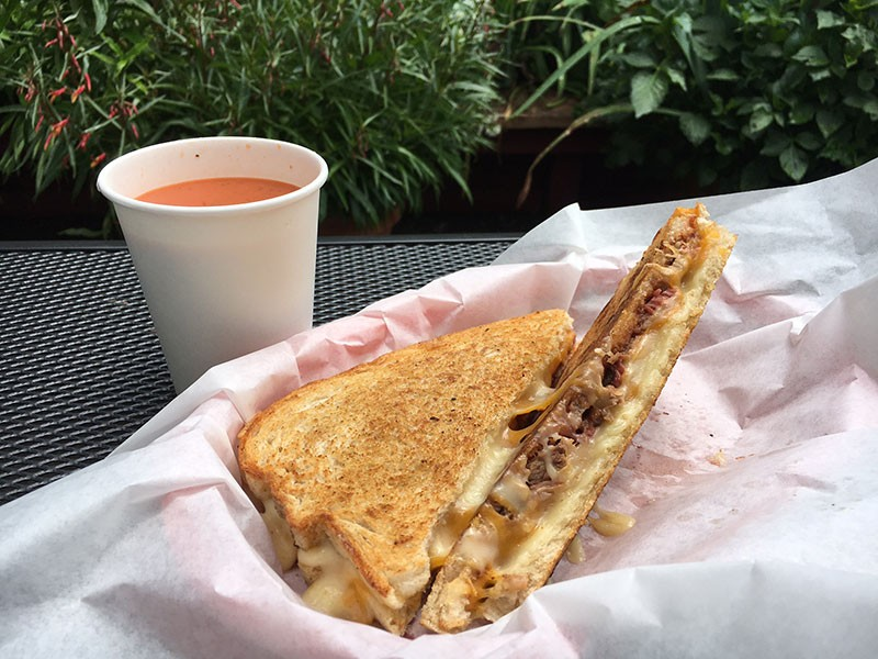 Brisket grilled cheese in the garden. - JENNIFER FUMIKO CAHILL