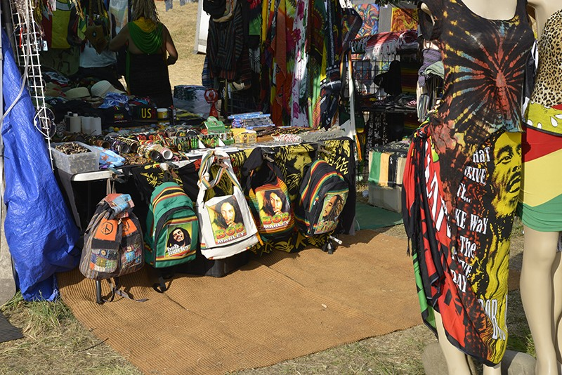 Bob Marley's likeness continued to be popular on backpacks and other merchandise items, like the ones photographed here Sunday afternoon. - PHOTO BY ERICA BOTKIN