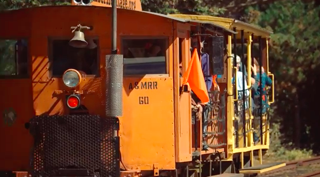 A speeder car on the tracks by the Samoa roundhouse. - TIMBER HERITAGE ASSOCIATION VIDEO