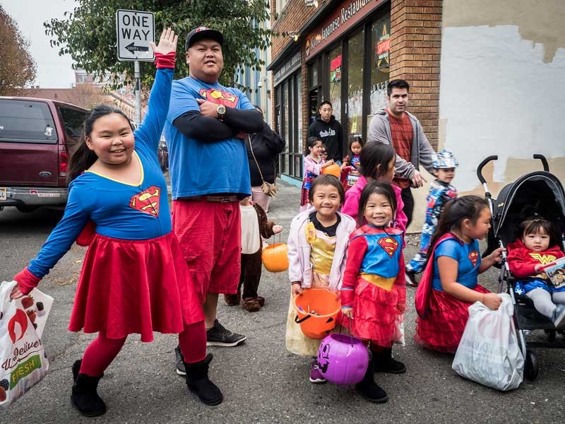 A super family touched down in Old Town for Halloween trick or treating. - PHOTO BY MARK LARSON