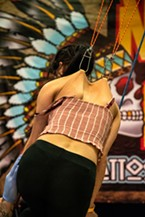 The aerial Human Suspension Sideshow with Dustin Mathis (of SB Body Arts in Oklahoma City) used hook suspensions in the skin on the back of Alexandrea Bettis, of Loleta, to lift her off the ground for a soaring adventure.