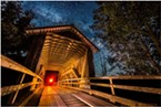 Also off of Elk River Road, Zanes Road covered bridge is another half-mile or so past Berta Road. The red light at the end of the tunnel is me holding my headlamp.