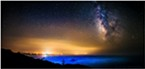 The Milky Way looms over the Pacific Ocean, standing out over the smoky, misty air along California's North Coast. Smoke from inland fires lingered in the sky. August 2015.