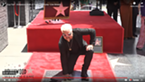 A screenshot of Guy Fieri and his star.