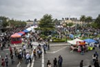 Thousands gathered on the Arcata Plaza to stand in line to buy oysters, listen to music or have a picnic on the grass.
