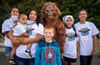 """Vanessa Raglin (second from left), of Fall River Mills, joined """"Bigfoot"""" (her uncle James Kleinhans, of Klamath) and family members for a photo prior to the Ney-Puey Color Run on Saturday morning."""