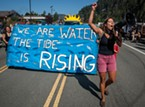 This parade marcher led chants in support of tribal water rights, dam removal and environmental protection.