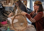 Denice McKenzie (foreground), of Arcata,  was one of 10 weavers representing the California Indian Basketweavers' Association and multiple tribes in the Pacific Northwest doing Native American basket-weaving demonstrations.