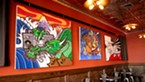 Paintings of Wong's hanging at the Diver Bar & Grill in Eureka.