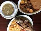 Minimalist white menudo, barbacoa and fried mojarra fish.