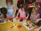 Children make applesauce ornaments at the annual Children's Holiday Gift Making Workshop.