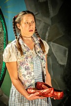 Dorothy (Sara Kei Wegmüller) is offered the ruby slippers to allow her return to Kansas.