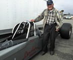 Dave Lindstrom, an 84-year-old local legend, with his dragster in the Samoa Dragstrip pits.