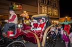 Santa and Mrs. Claus circled the plaza in their horse-drawn carriage before meeting the waiting crowd of children.