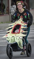 Nicki Leonardo, of McKinleyville, with 3-month-old Vina in the decorated stroller head for the finish line.
