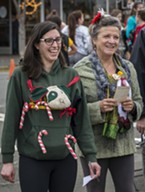 Providing discerning taste in what counted as ugly, Arcata city council members Sofia Pereira (left) and Susan Ornelas (along with Justin Mcdonald) were judges for the Ugly Sweater Holiday Run in Arcata on Sunday.