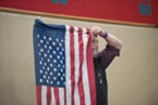 Supervisor Rex Bohn stunt doubled as a flag pole during the Pledge of Allegiance.
