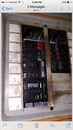 A repaired breaker box from a Squires property.