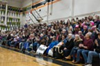 People flocked to Arcata High School, many with signs in hand, Thursday for a town hall meeting with North Coast Congressman Jared Huffman.