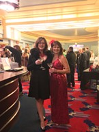 Donna Wright in Venetian vintage mink and Donna Landry in head-to-toe red.