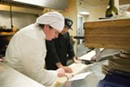 Chef Daniel Dagorret, left, of Hotel Carter's Restaurant 301, reviews the evenings menu with Josh Wiley.