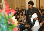 Elijah Chandler stands with David Josiah Lawson's mother at the celebration of life for her son.