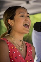 Nayelli Zechman joined The Chimney Swifts (a group of high school-age students from Arcata High School in their first public performance) as vocalist on one song on the Dell'Arte Street Stage during Saturday's All Day Free Fest at the Humboldt Folklife Society's Folklife Festival in Blue Lake.