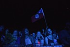 Women in the front row during J. Boog's set Saturday evening. One waves a J. Boog flag.