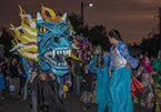 Friday's Elemental Spectacle procession was led by stiltwalkers and a dragon.
