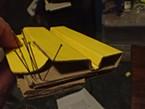 Folding an impromptu spreading board from cardboard box.