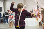 Sylas Vance who is Alaskan Aluet, learned some of the moves for the Hoop Dance.