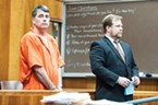 Gary Lee Bullock stands next to his attorney, Kaleb Cockrum, at his arraignment in January of 2014.