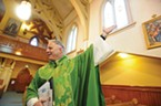 Father Eric Freed during the 125th anniversary Mass at St. Bernard's Church in 2011.