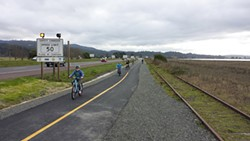PHOTO BY HANK SEEMANN - Biking the new stretch of trail between Eureka and Arcata.