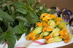 PHOTO BY HÉCTOR ALEJANDRO ARZATE - Amaranth greens, or quintoniles and flor de calabaza, squash blossoms, from the farmers market.