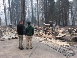 SUBMITTED - North Coast Assembymember Jim Wood, left, stands next to Paradise high school principal Loren Lighthall, who is seeing the remains of his home for the first time on Nov. 14.