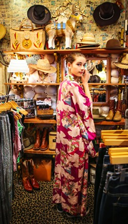 AMY KUMLER - A young shopper cultivating her style among selections of new and vintage goods.