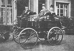 WIKIMEDIA COMMONS - Thomas Parker (middle) in one of his electric cars, circa 1895.