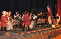 [Caption: Scotia Band, conducted by Dr. Ken Ayoob, performing at the - Winema Theatre recently. This year will host Music Night at Fortuna River Lodge - on March 15 at 7:30 pm. Admission is free.]