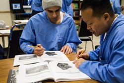 PHOTO BY T.WILLIAM WALLIN - David Nguyen (right) works with a fellow student on a plant experiment in a College of the Redwoods biology lab course at Pelican Bay State Prison.