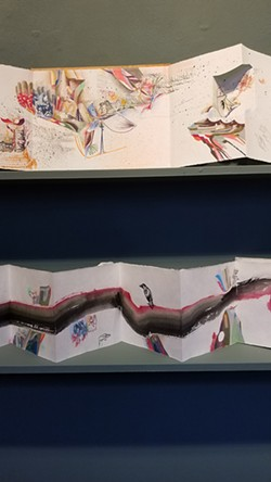 "PHOTO BY GABRIELLE GOPINATH - Artworks by Laura Corsiglia. Above: ""Drawing in the Shape of a Book: Silver Brother,"" 2018, ink, pencil, color pencil on paper with ink on paper covers (detail). Below: Detail of ""Book of passage: Perch,"" 2019, ink, pencil, color pencil on paper with ink on paper covers."